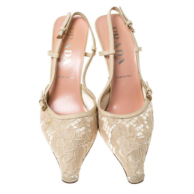 This pair of sandals by Prada will leave you looking like a diva. They are crafted from beige satin and lace with leather trims and assembled with pointed toes and 9cm heels. Add a touch of feminity to your closet by slipping into this pair of