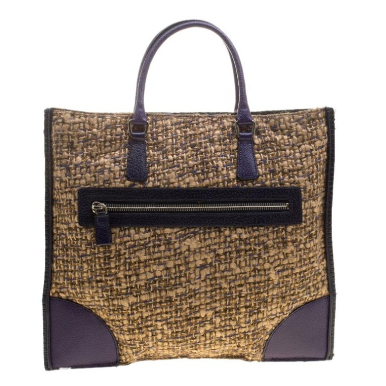 Totes as pretty as this one by Prada are not creations you find every day. That's why this bag is worthy of a place in your closet. It has been crafted from tweed and styled with leather patches. The tote has a spacious nylon interior and it is held