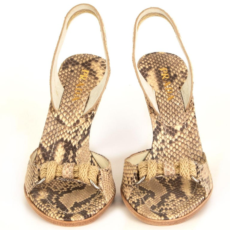 100% authentic Prada slingback sandals in beige and taupe python. Knot application in natural cord and silver tone D-ring. Brand new.  Measurements Imprinted Size36 Shoe Size36 Inside Sole23.5cm (9.2in) Width7.5cm (2.9in) Heel10.5cm