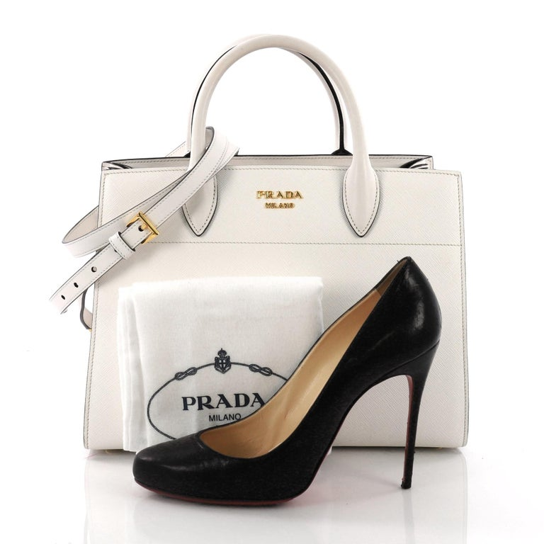 This Prada Bibliotheque Handbag Saffiano Leather with City Calfskin Medium,  crafted from white saffiano leather a45a09337d