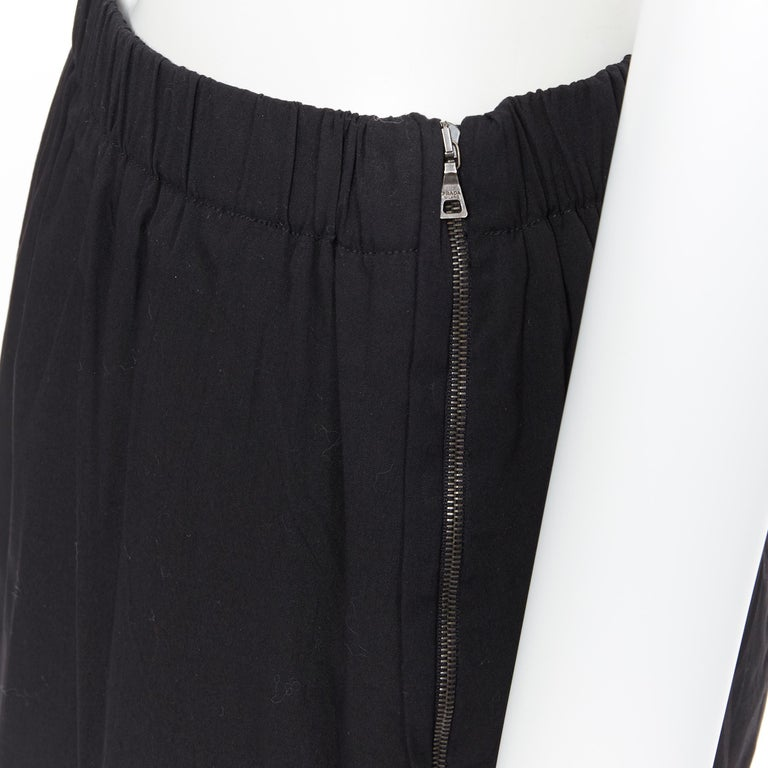 PRADA black cotton blend elasticated waist center vent casual skirt IT42 Brand: Prada Designer: Miuccia Prada Model Name / Style: Cotton skirt Material: Cotton blend Color: Black Pattern: Solid Extra Detail: Mid rise. Made in: Italy  CONDITION: