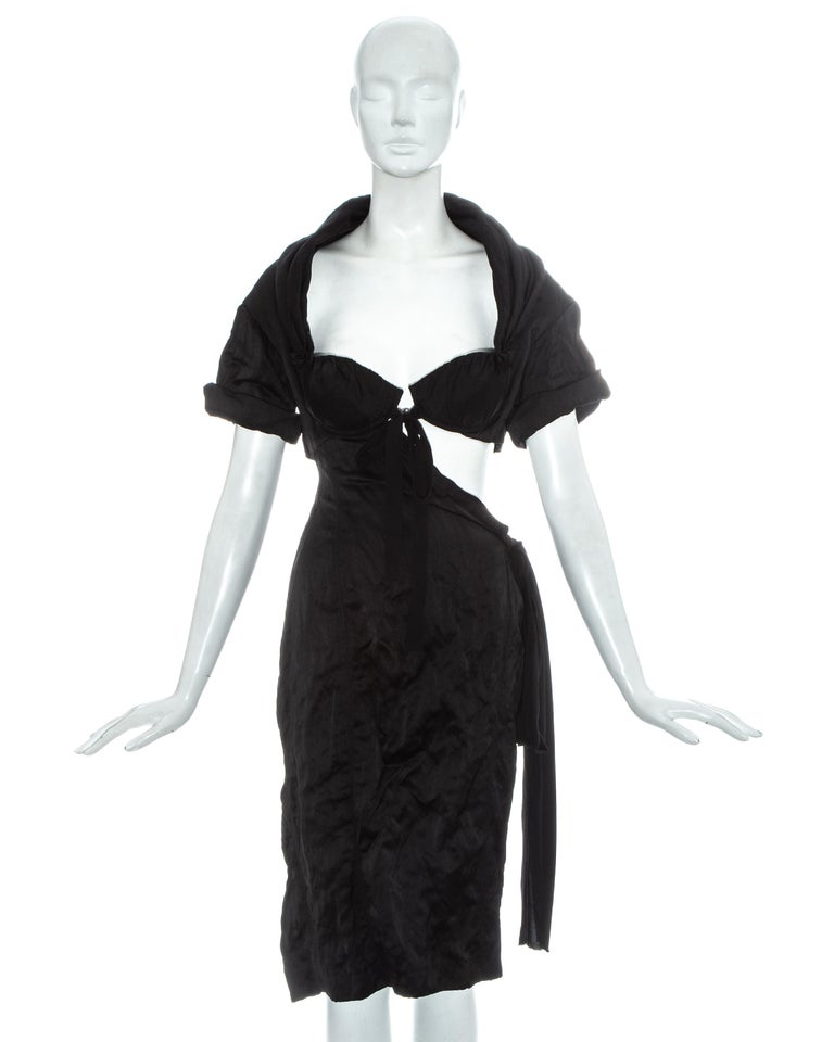Prada black crinkled evening dress with cut out on hip, drawstring waistband, ribbon fastenings and built in bra.  Spring-Summer 2009