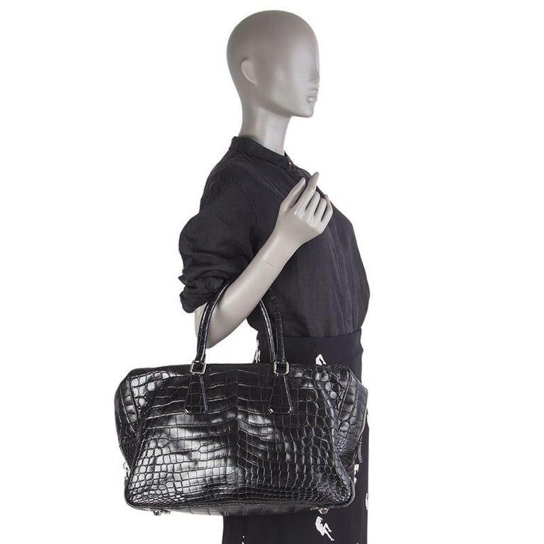 Prada 'Large Top Handle' bag in black crocodile. Closes with a zipper on top. Lined in black leather with a zipper pocket against the front and back. Has been carried and is in excellent condition. Retails for CHF 26'000.  Height 27cm (10.5in) Width