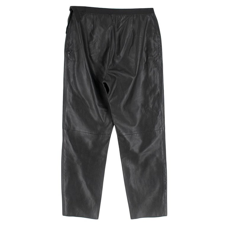 Prada Black Leather Trousers - Ribbon finish at waist with excess near zipper - Fully lined - Pockets in good condition - Zipper on left in good condition - Rough finish at ankle  Please note, these items are pre-owned and may show signs of being