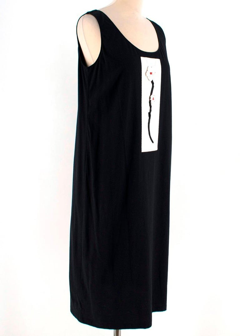 Prada black dress featuring a round neckline, a mid-length and an embroidered flower to the front.   - Sleeveless design - Straight fit  Please note, these items are pre-owned and may show signs of being stored even when unworn and unused. This is