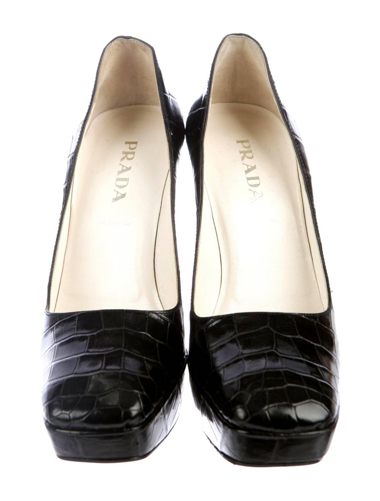 A PRADA signature piece that will last you for years     Pure luxury! A real statement piece     With platform and very high heels - for ultra-long legs! The most luxurious skin you can find on earth - shiny, thick, black leather - just