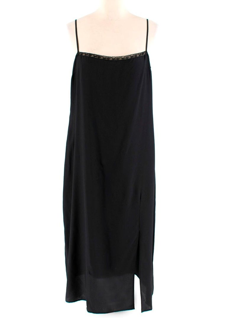 Prada- Black Feather-trimmed silk-georgette midi dress  - Sheer silk georgette - Silk slip underdress - Feather trim to the cuffs and skirt - Cropped sleeves - Slips on with button closure at the neck - Elasticated waist  - Keyhole back - Loose slim