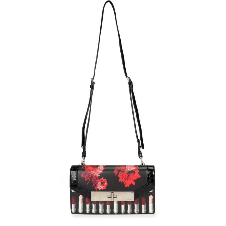 Prada Black Floral & Lipstick Print Leather Séverine Bag SKU: 106960 MSRP: USD 3,600.00  Condition Description: The always cheeky Prada introduced the Séverine bag in 2018. This version features a floral and lipstick print with embossed