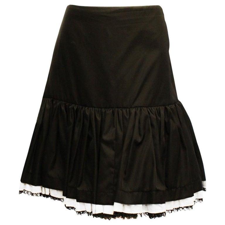 1b8e46a7f9cf8 Prada Black Gathered Skirt with Ruffle Hem with White Lace Trim