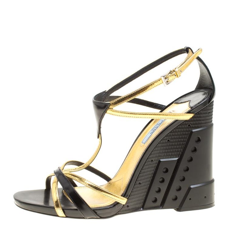 5e9be0e0 Prada Black/Gold Leather Retro Futuristic Ankle Strap Geometric Wedge  Sandals Si