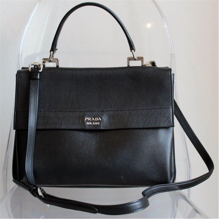 Very chic Prada bag Black color Red interior color Can be carried crossbody too (removable) Clip closure Double compartment, plus central one Three internal pockets Cm 28 x 22 x 16 (11 x 8.7 x 6.3 inches) Worldwide express shipping included in the