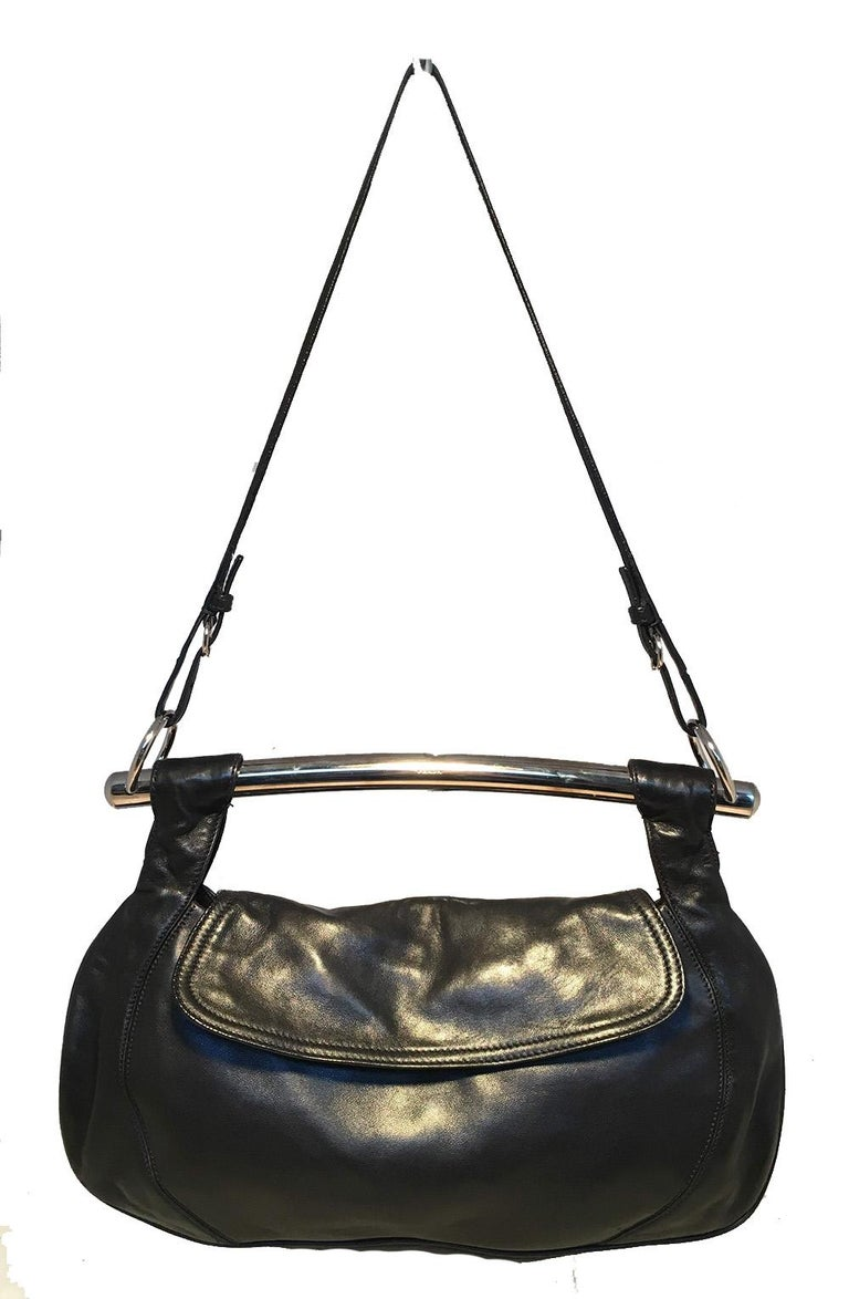 Prada Black Leather Bar Top Handle Convertible Handbag in very good condition. Soft black calfskin leather exterior trimmed with silver hardware and signature enamel logo plate on back side. Top Silver bar handle and attached thin black leather
