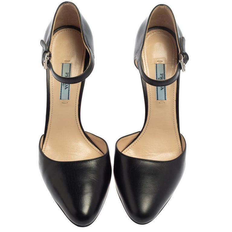 These exquisite pumps from Prada are worth splurging on. Crafted in luxurious leather, these pumps flaunt almond toes, ankle fastenings, and 11.5 cm heels. They come with comfortable leather-lined insoles and are sure to lend your personality oodles