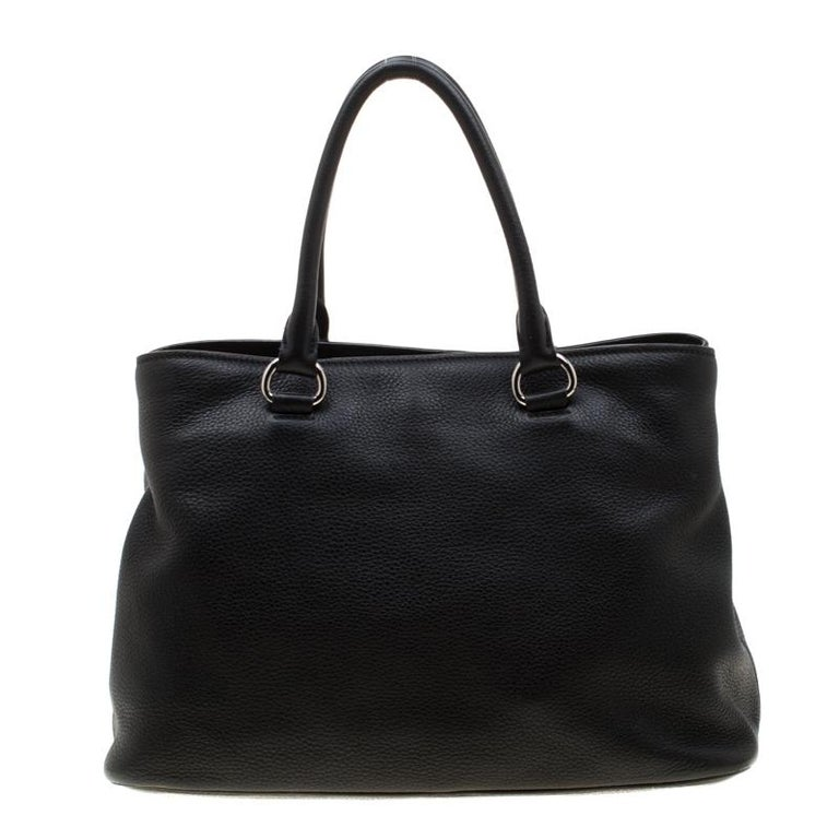 This Prada piece is an example of the brand's magnificent designs fused strikingly with the up-to-the-minute trends in fashion. The bag is crafted from leather and is equipped with two handles and a spacious nylon interior. Grab a fashionable look