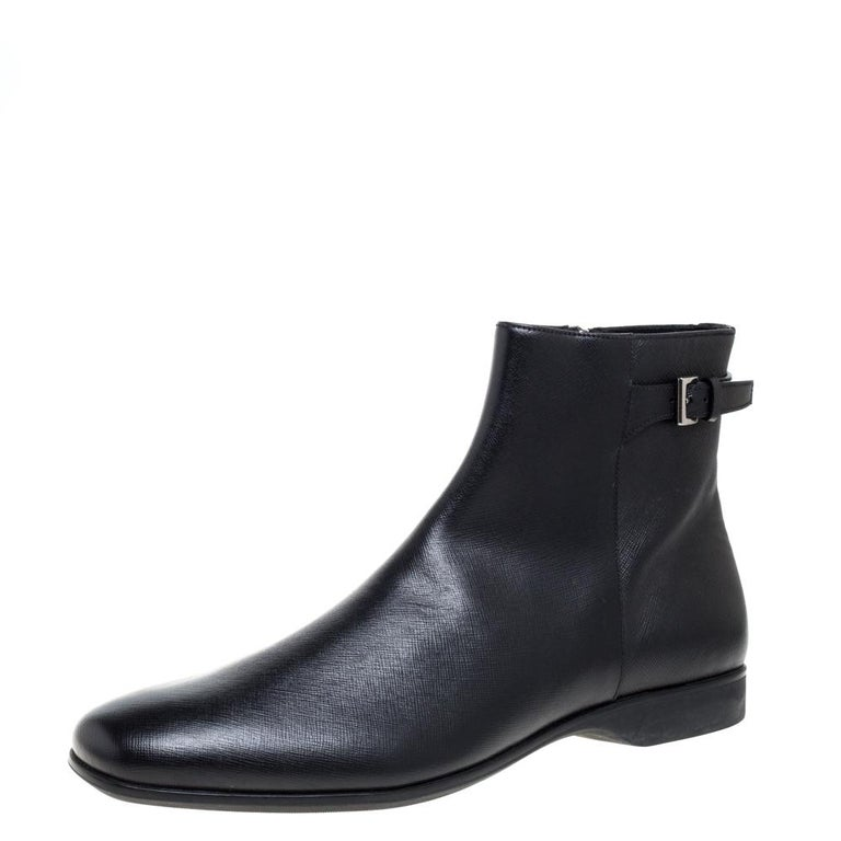 Prada promises to elevate your style with this distinguished pair of boots. Casual Fridays will look so much better at work thanks to these. They have been crafted from black-hued leather and have smart square-shaped toes. They are styled with a
