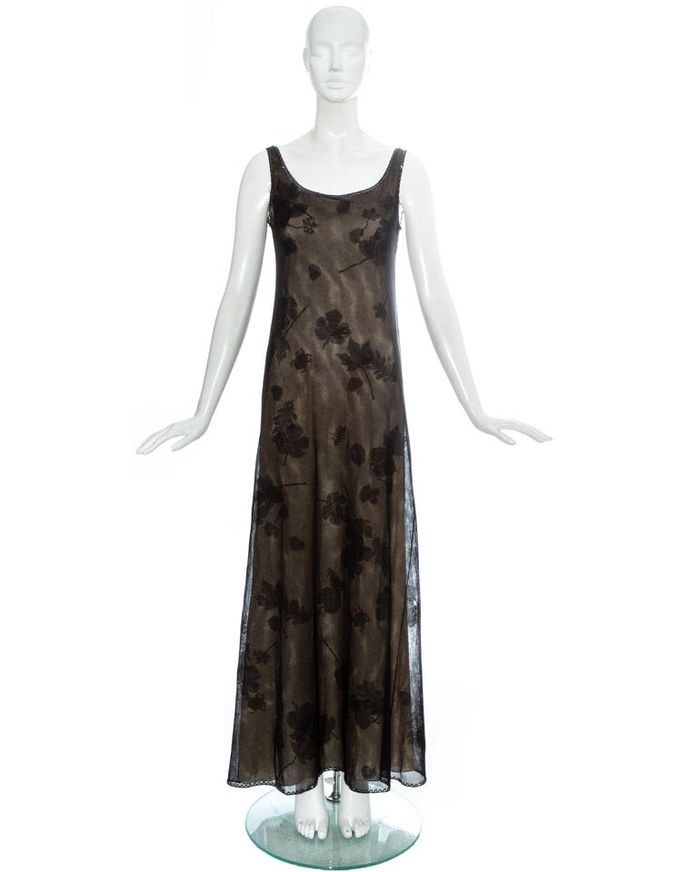 Prada black mesh evening maxi dress with beaded trim around collar and hem, appliquéd fabric leaves and detachable nude silk slip dress  Fall-Winter 1999