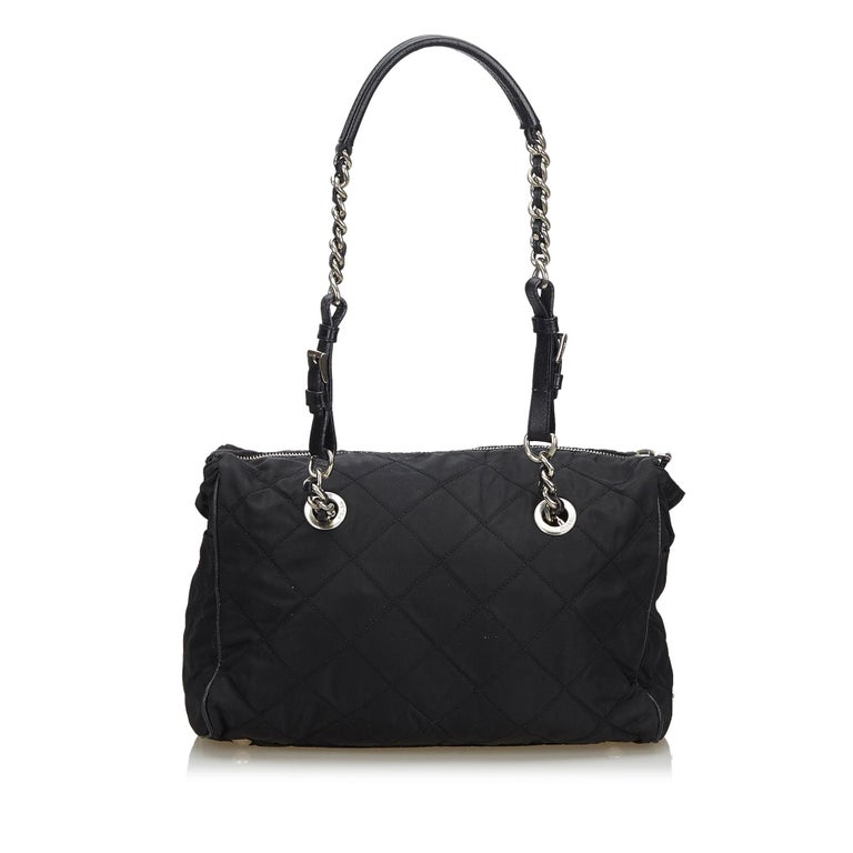 Prada presents an exclusively designed exquisite tote bag for the stylish you. A stylish option for everyday use or special events, this impressive black tote is true to its existence. This attractive piece crafted with fabric, nylon and leather