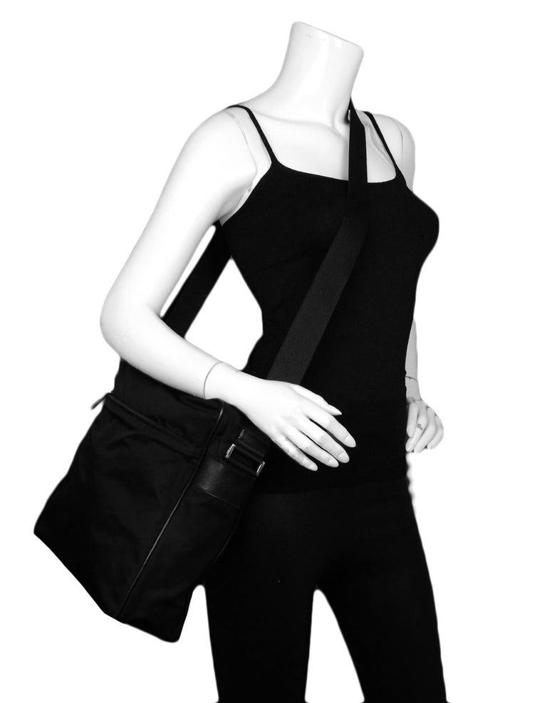 Prada Black Nylon Zip Top Messenger Bag  Made In: Italy Color: Black  Hardware: Silvertone  Materials: Nylon Lining: Prada fine textile Closure/Opening: Top zip Exterior Pockets: One zip pocket Interior Pockets: One zip pocket Exterior Condition: