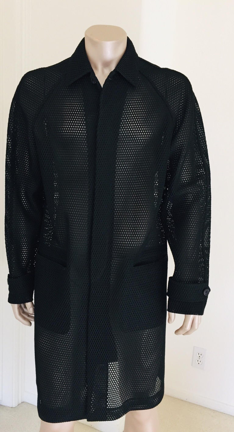 Prada black overcoat. Flap pockets on the side Adjustable straps on the cuffs Light summery overcoat, see through lace. Size 52. Garment length: 44 inches. Made in Italy. Like new. Prada Milano black label.