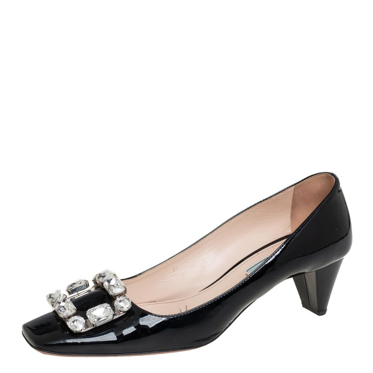 Add this exquisite pair of Prada pumps to lend an added element of comfort. Feel beautiful and be comfortable while flaunting these patent leather pumps, enhanced with crystal embellished buckle detail on the vamps. Upgrade your everyday look by