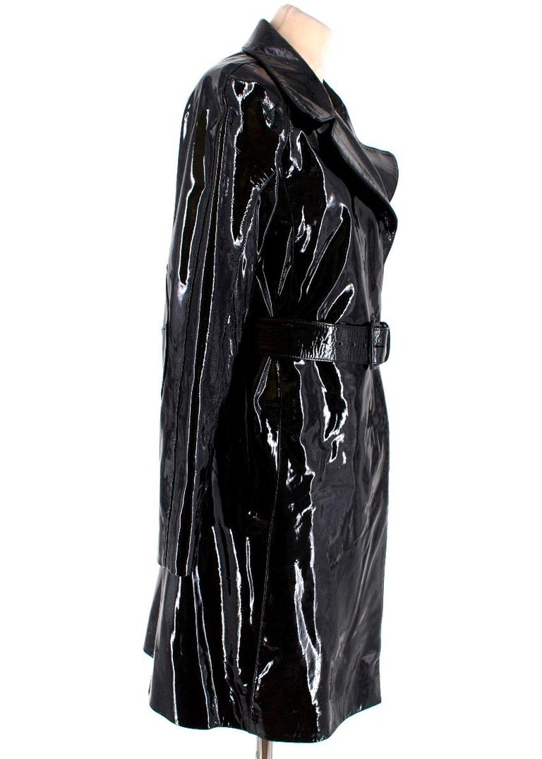Prada Black Patent Leather Trench Coat  - Black glossy patent leather - Trench coat - Belted - Slanted slip pockets - Press stud fastening - Collar and lapels - Embroidered elbow patches - Lined  Postage is set to cover insurance and will be