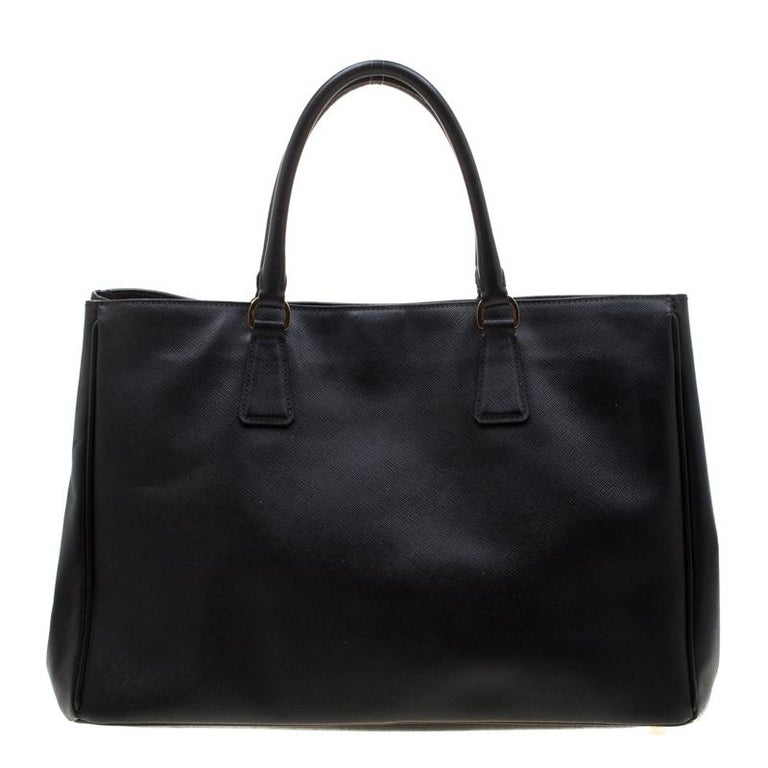 High in appeal and style, this tote is a Prada creation. It has been crafted from Saffiano Lux leather and shaped to exude class and luxury. The bag comes with two handles and a spacious nylon interior for your ease. Protective metal feet and the