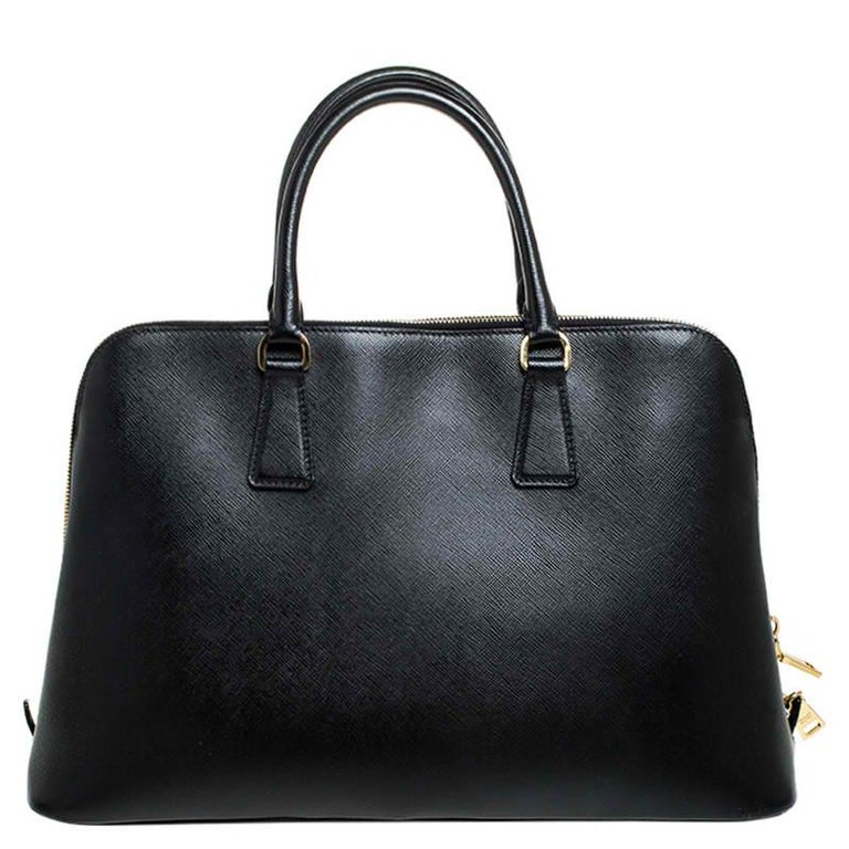 This stunning Promenade bag is high on appeal and style. Dazzling in a classy black shade, the bag is crafted from leather and features two rolled handles. The zip closure leads way to a nylon interior with enough space for your essentials and the