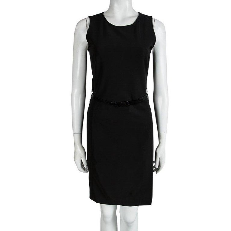 A classic black shift dress will never let you down and be a permanent essential piece. This Prada black sleeveless shift dress will be a perfect work wear piece, while still be an alternative for formal event wear. This dress features a black waist