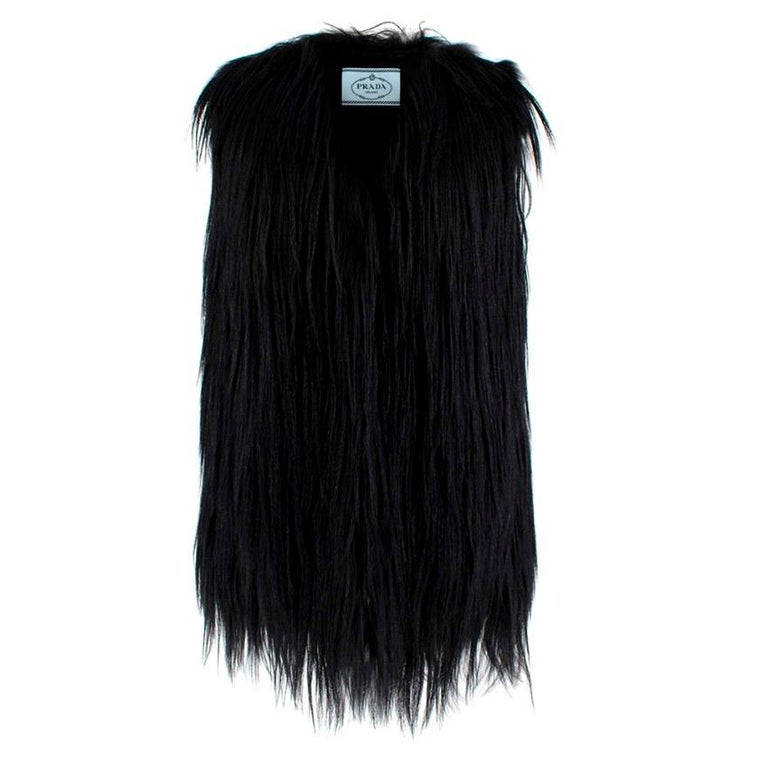 Black Prada Sleeveless Goat Fur Jacket   - Inside Clasp Fastenings Through Centre   - Relaxed Shape  -Light Lining   Material - 100% Dyed Goat Fur (China) - 100% Dyed Fox Fur (Finland) - 100% Silk - Specialist Fur Clean Only   Made in