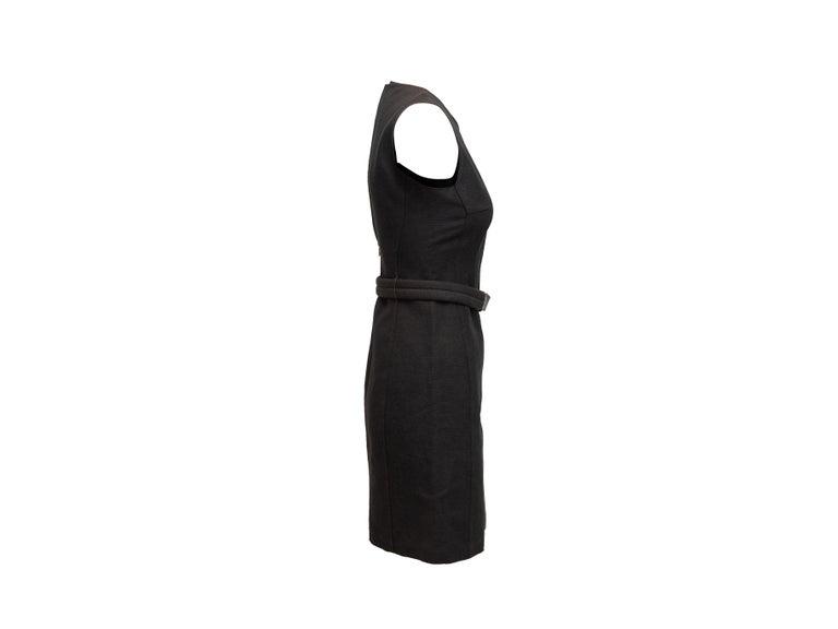 Product details: Vintage black linen-blend sleeveless mini dress by Prada. Crew neck. Belt at waist. Zip closure at back. 31