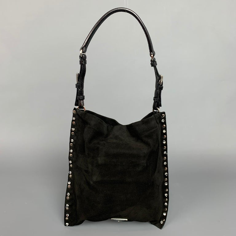 PRADA handbag comes in a black suede with a nude satin liner featuring embellished rhinestones, adjustable top handle, inner pocket, and a snap button closure. Comes with dust bag and identification cards. Made in Italy.  Very Good Pre-Owned