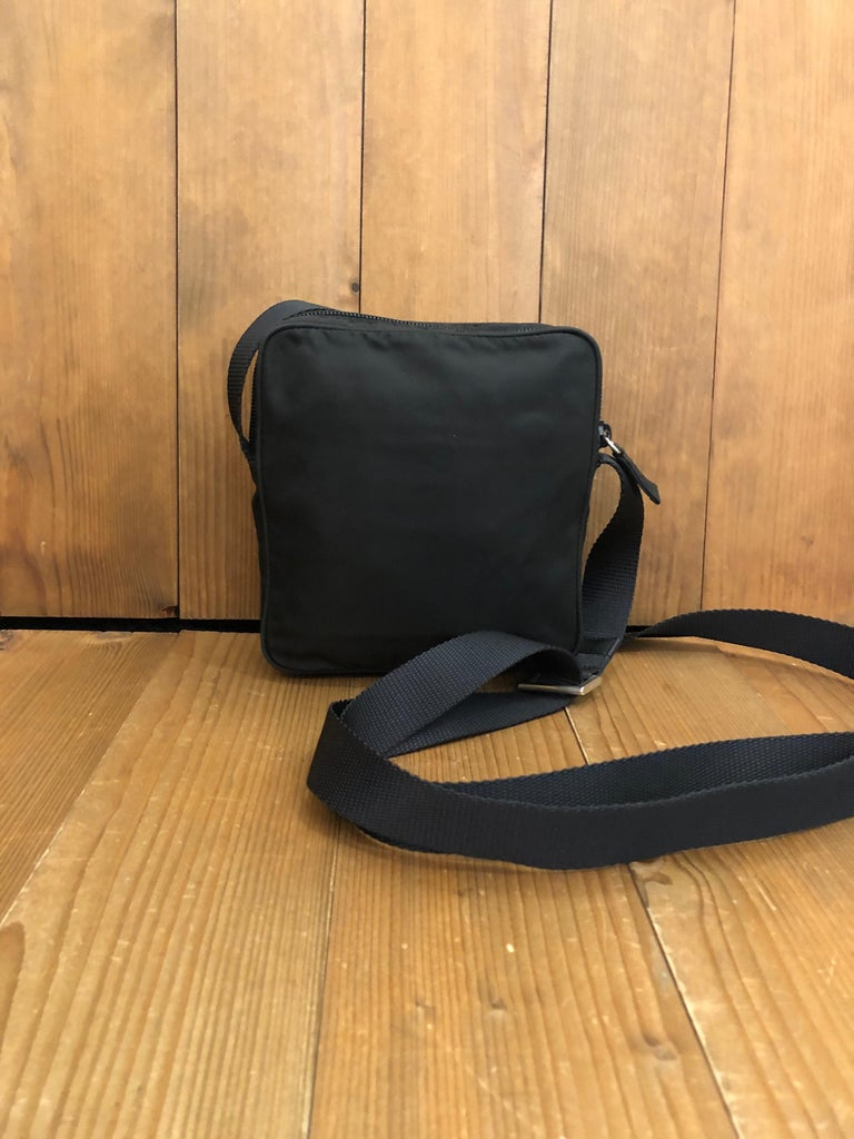 """PRADA Black Tessuto Mini Crossbody Bag Unisex Material: Polyester Color: Black Origin: Italy Measurements: 5.9""""x6.1""""x1.5"""" Drop 28"""" (at its longest) Specifications: 1 exterior zip pocket  Condition: Outside: Minor marks Inside: Clean Pockets:"""