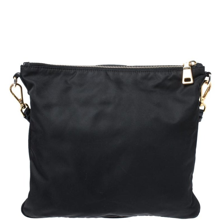 From the house of Prada comes this gorgeous crossbody bag. It flaunts the brand logo on the front and has been crafted from nylon. The zip closure opens to reveal a well sized interior and the bag is complete with an adjustable shoulder