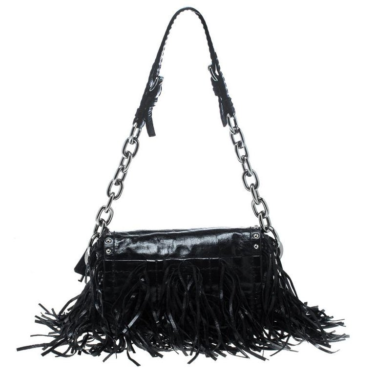 You'll love carrying this stunning Vitello Shine bag from Prada that is sure to grab you a lot of compliments. The black bag is crafted from leather and features a chic silhouette. It flaunts fringe detailing on the exterior and comes with a push