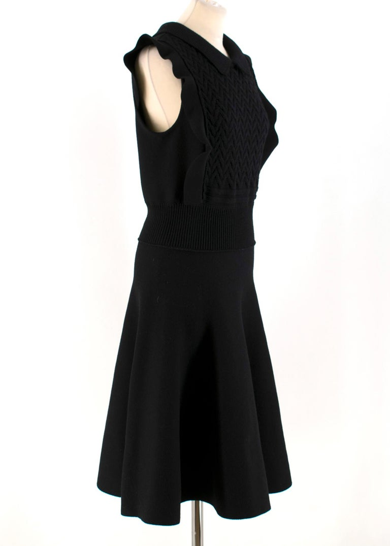 Prada Black Wool-blend Knitted Dress  - Black, heavy-weight, wool-blend knitted dress - Pointed collar - Sleeveless, ruffled-trimmed shoulders - Elasticated waist - Flared skirt - Centre-back button and zip fastening  Please note, these items are
