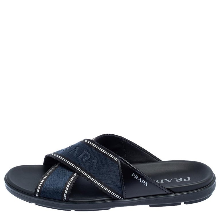 These blue slides by Prada are stylish and super comfortable. They have been crafted from leather and nylon and designed with open toes and logo-detailed crisscross vamp straps. Easy to slip on, they come with leather-lined insoles and durable