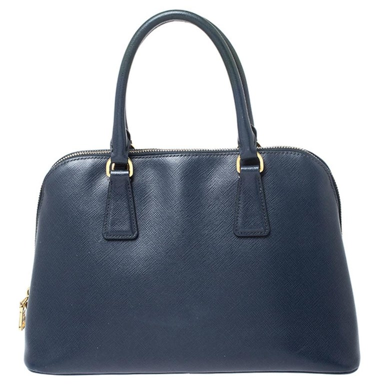 This stunning Promenade bag is high on appeal and style. Dazzling in a classy blue shade, the bag is crafted from leather and features two rolled handles. The zip closure leads way to a nylon interior with enough space for your essentials and the