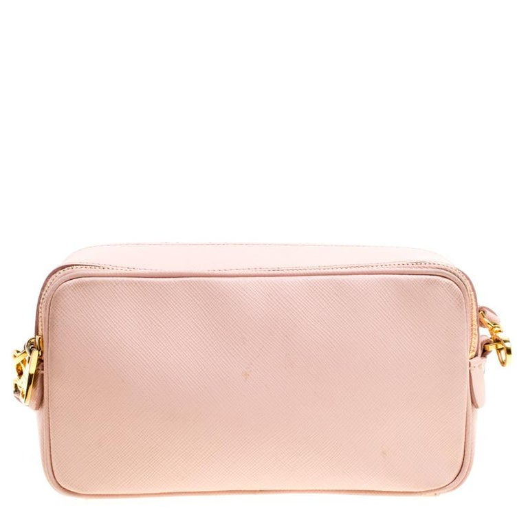Bags are more than just instruments to carry one's essentials. They tell a woman's sense of style and the better the bag, the more confidence she gets when she holds it. Prada brings you one such fabulous bag meticulously made from blushed pink