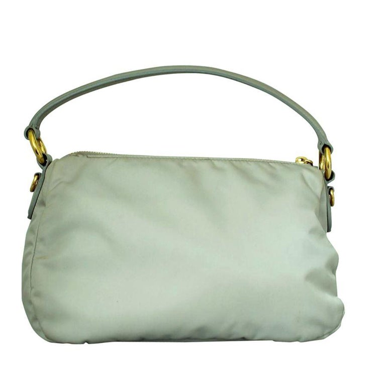 Beautiful Prada bag Sailcloth  Pearl grey color Leather handle Central bow Zip closure Internal zip pocket Golden metal inserts Cm 28 x 16 x 12 (11 x 6.2 x 4.72 inches) Fast international shipping included in the price.