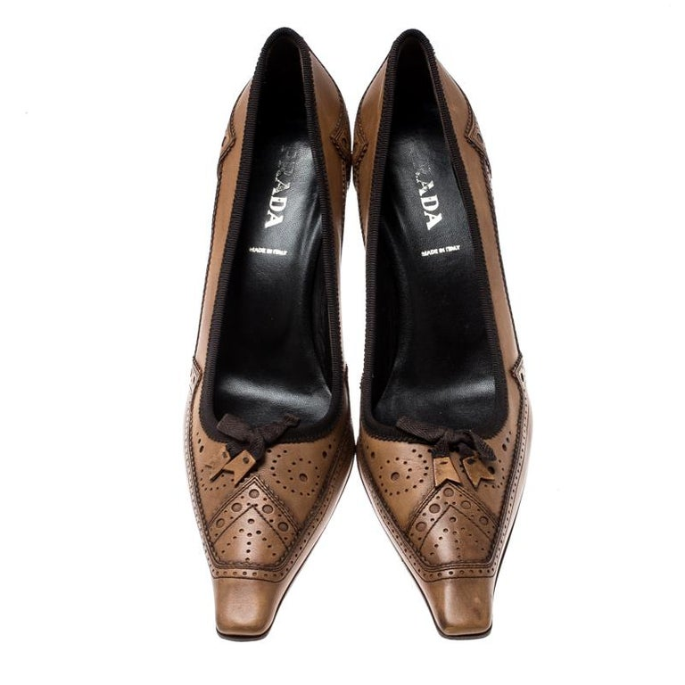Showcase the latest trends in fashion when you wear this pair of brogue leather pumps. With this one, Prada has brought yet another comfortable pair. In a world of basics, this pair of brown pointed-toe pumps sets your style apart.