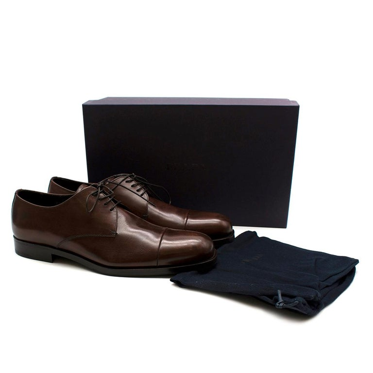 Prada Brown Leather Lace-up Shoes   - Made of smooth leather  - Patina effect  - Neutral brown hue  - Lace up fastening  - Soft leather lining  - Original box and dust bag  - Rubber inserts to the soles  - Timeless elegant design