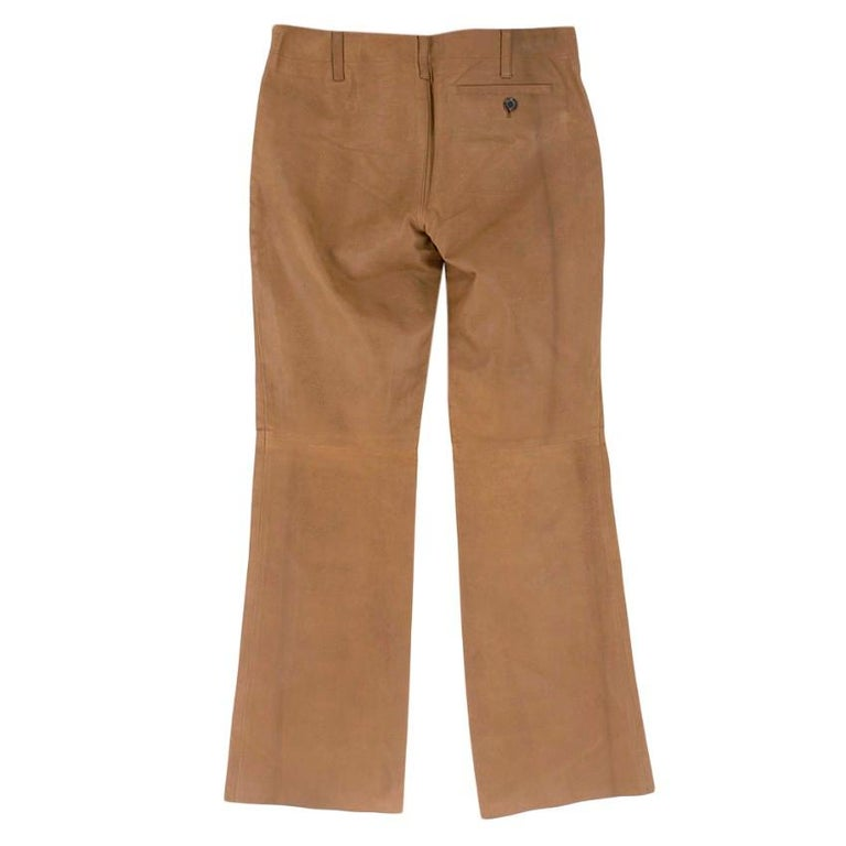 Brown flared leather pants from Prada featuring a low waist and a cropped length.   - Concealed side zipper - A back pocket - Made in Italy  Please note, these items are pre-owned and may show signs of being stored even when unworn and unused. This