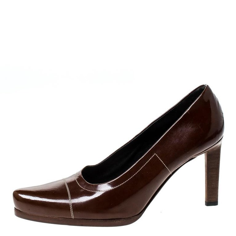 Designed to perfection, these pointed-toe pumps are from the famous luxury house of Prada. They are covered in patent leather and balanced on 9.5 cm heels. Feel your best every time you slip into these brown pumps.  Includes: The Luxury Closet