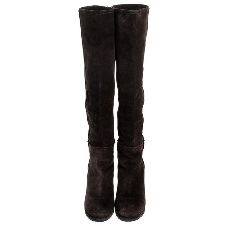 Simple and sophisticated, these knee-length boots from Prada are a must-buy for the fashionable you. These brown boots are crafted in suede and come balanced on wedge heels. They can be paired with a long tunic or an oversized shirt to make quite a
