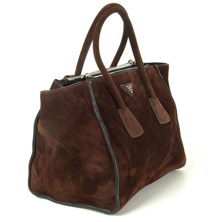 Prada 'Twin Pocket' tote in Mogano (dark brown) Scamosciato suede featuring silver-tone hardware. Opens with a push-button and is lined in smooth black lambskin with two extra large zip pockets on the side, a small zip pocket against the back and a
