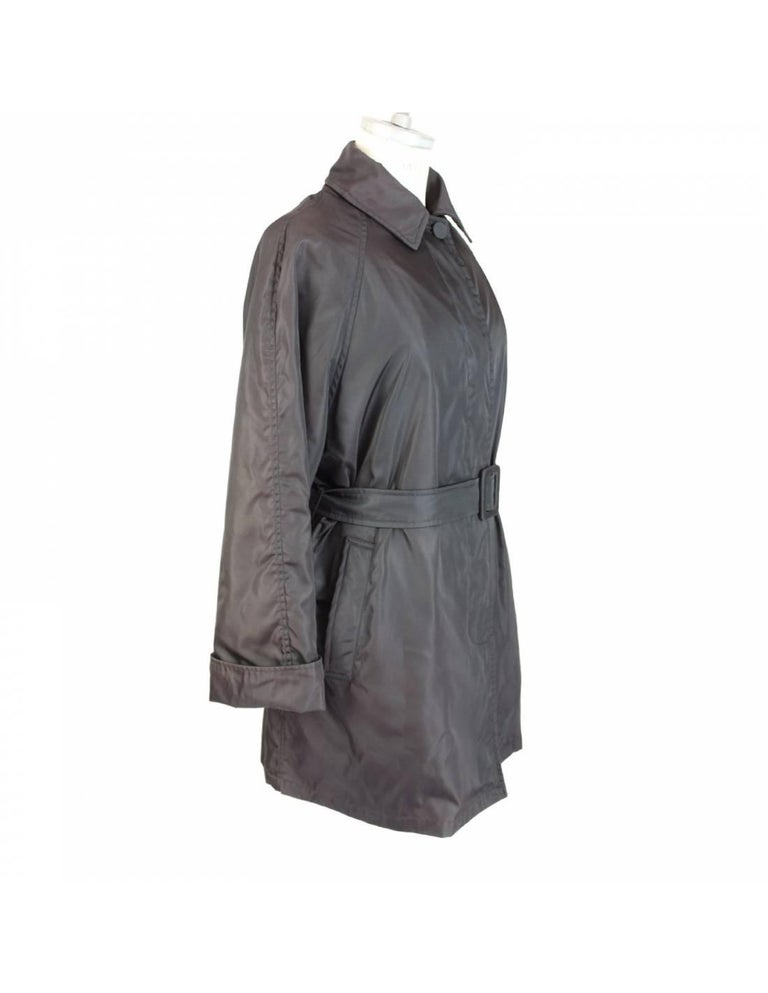 Beautiful waterproof coat by Prada brown 60% acetate 40% cupro. The coat is  completely padded on the sleeves, but the padding can be removed. It has two pockets on the sides and a belt. Made in Italy, 2000s, excellent condition.  SIZE 42 IT 8 US 10