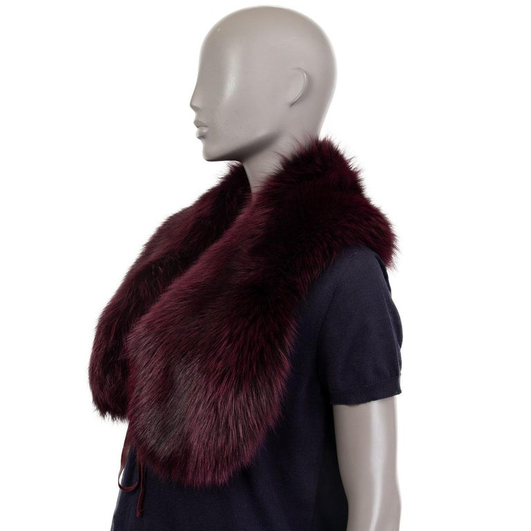 Prada shawl collar in deep burgundy dyed white fox fur with leather ribbons to close it on the front. Has been worn and is in excellent condition.   Width 21cm (8.2in) Length 100cm (39in)