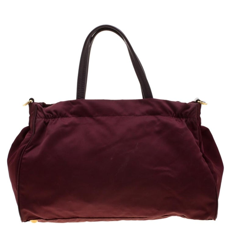 Stunning in appeal this tote by Prada will be a valuable addition to your closet. The tote is crafted from nylon and can be held using the dual handles or the shoulder strap. The bag flaunts a front zip pocket and a spacious interior that is secured