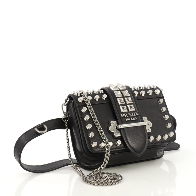 b604fa66e37d This Prada Cahier Belt Bag Studded City Calf with Saffiano Leather Small,  crafted in black