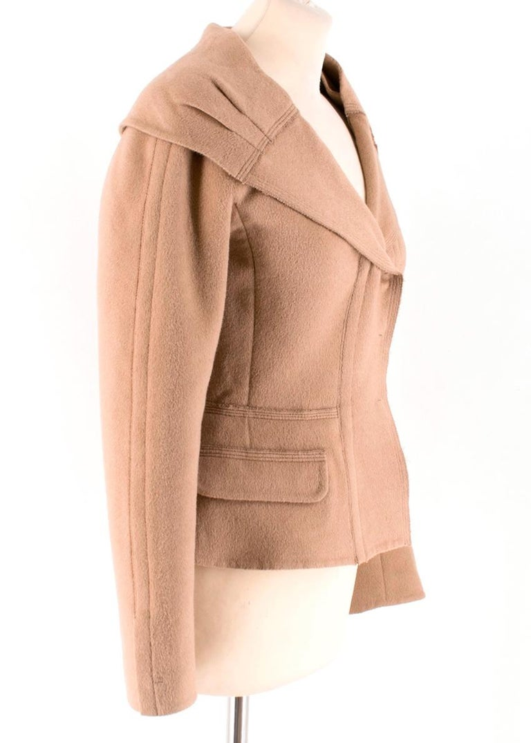 Prada Angora Jacket in Camel   - Snap fastenings  - Side Flap Pockets - Large Collar  - Peplum Hemline   52% Wool 48% Angora  Dry Clean Only  Made in Italy   Please note, these items are pre-owned and may show signs of being stored even when unworn